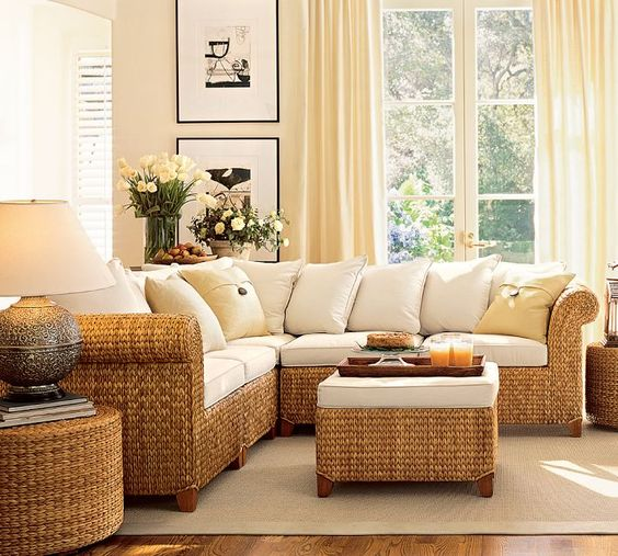 brown woven rattan corner sofa, woven rattan round coffee table, white cushion, cream rug, wooden floor, white wall, white crutain
