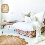 Brown Woven Rattan Low Chair, White Cushion, White Seamless Floor, Woven Pendant, Wooden Coffee Table