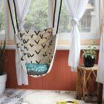 Corner Room, Orange Waiscoting, White Framed Window, Black White Rug, Cloth Hammock