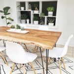 Dining Room, Light Wooden Floor, White Wall, Dented Shelves With Black Background, Wooden Table, White Modern Chairs, White Rug