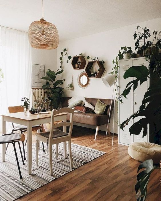 dining room, wooden floor, white wall, rattan pendant, brown leather cushion, white metal cupboard, wooden table, wooden chairs, rug