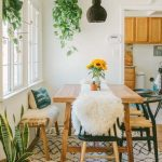 Dining Room, Wooden Floor, White Wall, White Ceiling, Wooden Table, Wooden Bench, Black Wooden Chairs With Rattan Seat, Rattan Plants Pot, Black Rattan Pendant