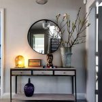 Entrance, Grey Wall, Grey Floor Tiles, Large Round Mirror With Black Frame, Light Wooden Console Table With Black Line, Pendant