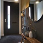 Entrance Hallway, Black Floor, Black Wall, Golden Wall, White Wall, Black Door, Wooden Bench, Rattan Asket, Large Round Miror