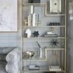 Golden Metal Shelves With Glass Support