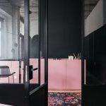 Kitchen, Black Wall, Pink Bottom Cabinet, Wooden Floor, Black Rug With Flowery Patterns