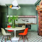 Kitchen, Green Wall, Green Bottom Cabinet, Pendant, Black White Plaid Backsplash, White Tulip Table, White Red Chairs, Geometric Floor Tiles