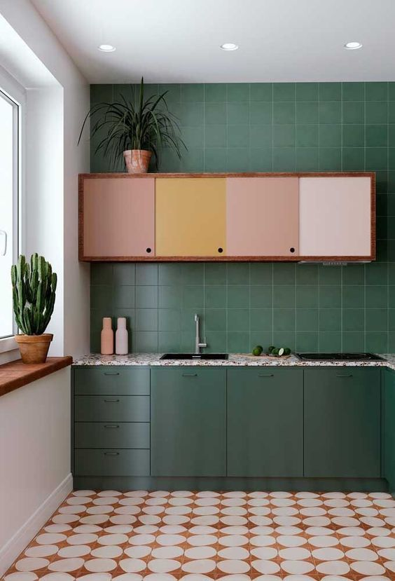 kitchen, green wall tiles, green bottom cabinet, white wall, brown pastel upper cabinet, brown white round floor tiles