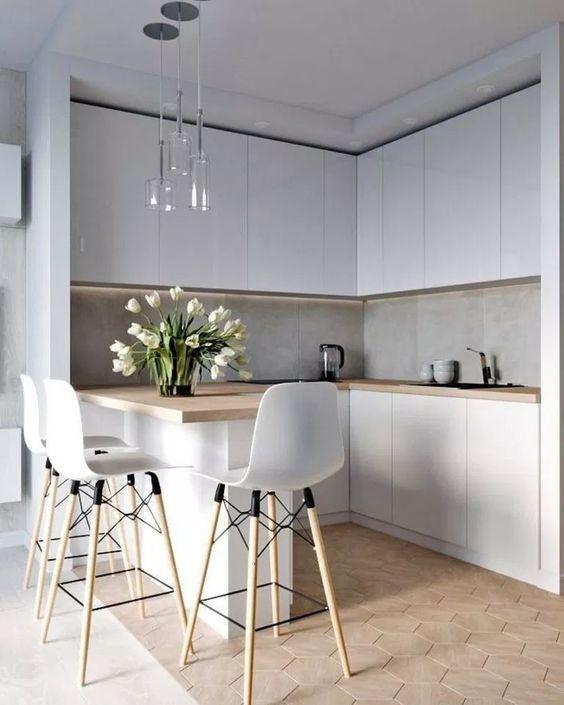 kitchen, white cabinet, grey backsplash, wooden counter top, island, white modern stools, wooden hexagonal floor tiles, glass pendant