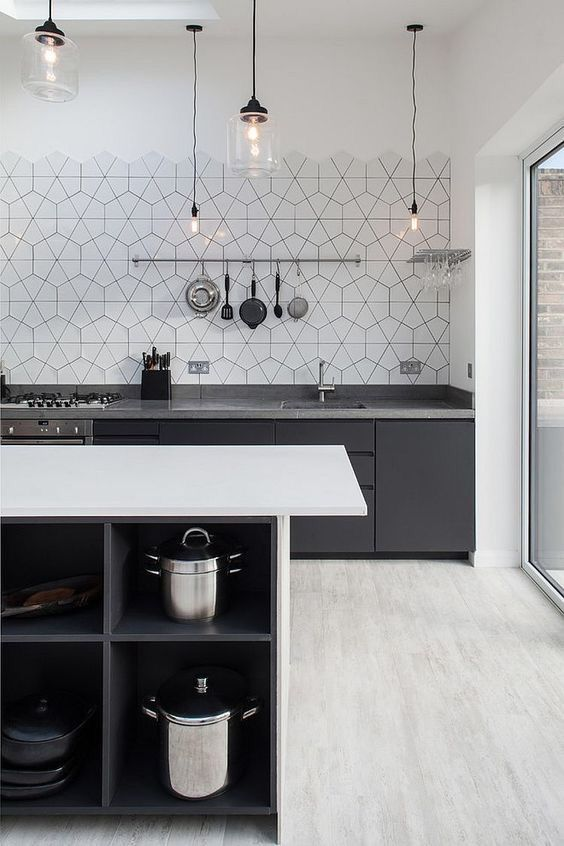kitchen, white marble floor tiles, white wall, hexagonal patterned backsplash tiles, black bottom cabinet, glass pendants, white island