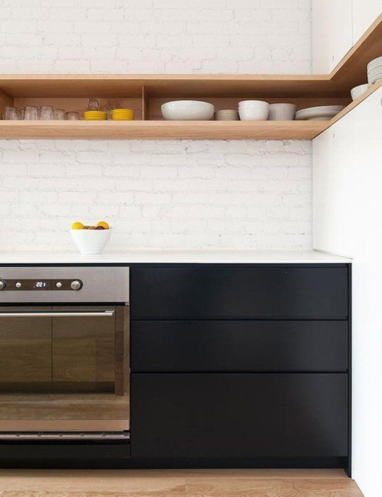 kitchen, wooden floor, white exposing wall, wooden shelves, black bottom cabinet