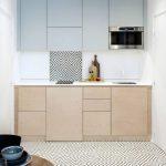 Kitchen, Wooden Floor, White Patterned Floor, White Wall, Wooden Cabinet, White Backsplash, Grey Upper Cabinet