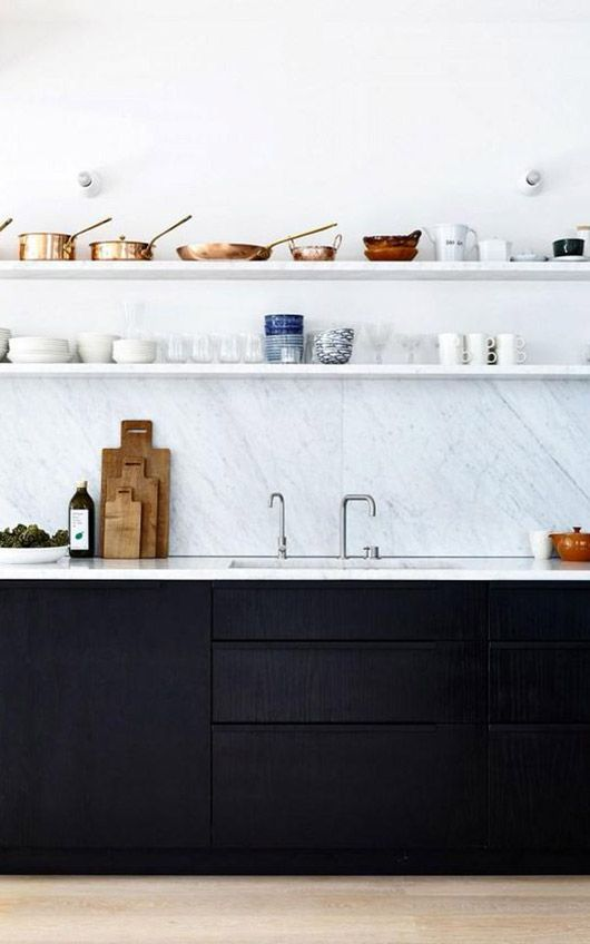 kitchen, wooden floor, white wall, white marble backsplash, black bottom cabinet, white counter top