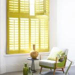 Lime Yellow Window Shutters, White Wall, Green White Brown Wood Chair, Black Low Side Table, Green Table Lamp