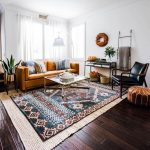 Living Room, Dark Wooden Floor, Patterned Rug, White Wall, Brown Leather Sofa, Black Leather Chair, Leather Ottoman