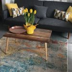 Living Room, Grey Floor, Grey Wall, Dark Grey Sofa, Wooden Coffee Table, Yellow Plant Pot, Yellow Pillows
