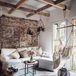Living Room, Grey Floor Rug, White Wall, Exposed Brick Wall, Wooden Beam Ceiling, Hanging Plants, Hammock Chair