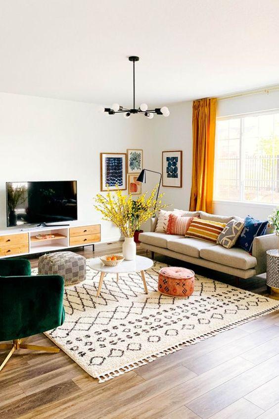 living room, wooden floor, white wall, light grey sofa, white round coffee table, white pendants, green velvet chair
