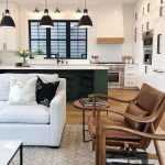 Open Living Room, Wooden Floor, White Subway Tiles, Black Pendant, Dakr Green Island With White Top, White Sofa, Brown Leather Cushion On Wooden Chairs, White Cupboard
