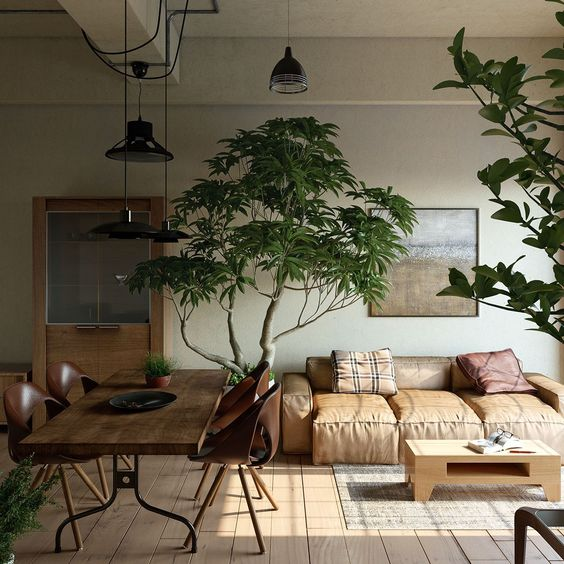 open living room, wooden floor, white wall, brown leather sofa, wooden table, brown chairs, plants, black pendants, low coffee table