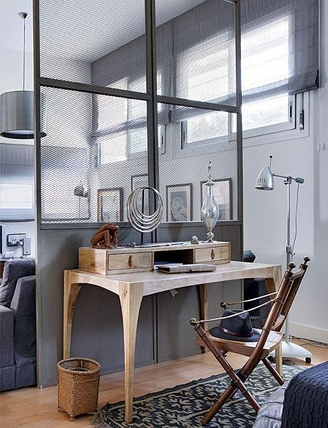 study, wooden table, wooden floor, grey wall, partition, grey pendant, grey sofa, grey patterned rug,
