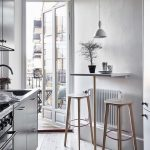 White Table Mounted On The Wall, Wooden Stools, White Pendant, Wooden Floor, Silver Cabinet