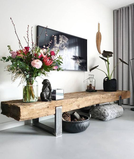 white wall, thick wooden bench with metal support, grey seamless floor, flowers and plants