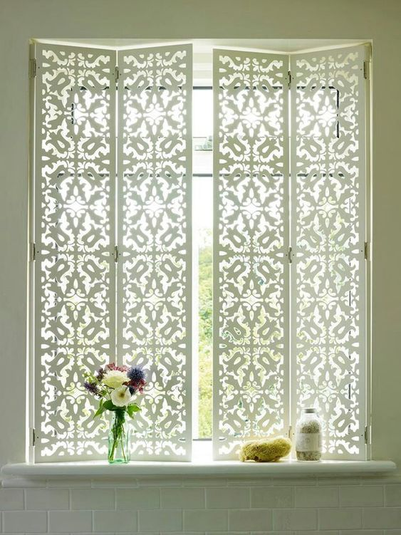 white window blinds with patterns, white wall, white subway tiles