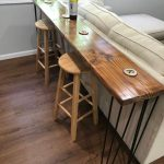 Wooden Bar Table, Wooden Stools, Wooden Floor, White Sofa, Grey Wall, Glass Windows