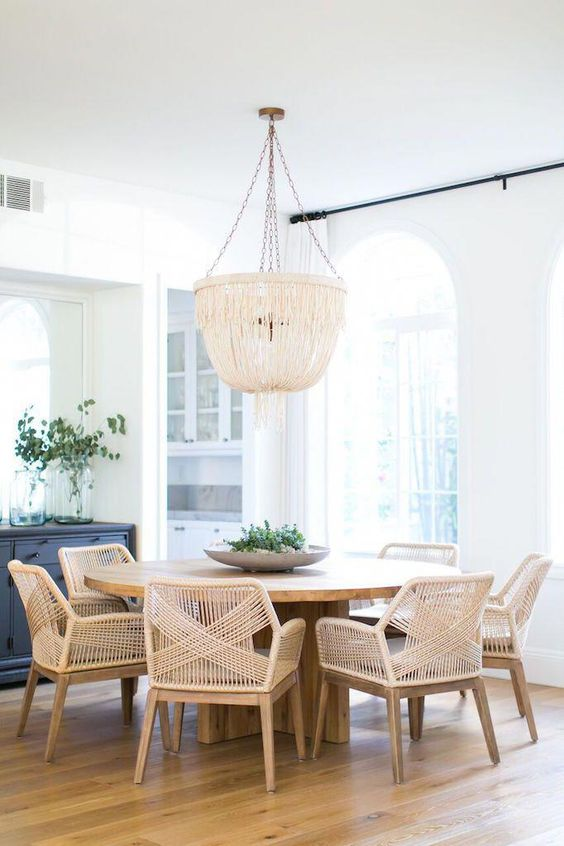wooden dining set, rattan seat and back, wooden flor, natural chandelier, round wooden table