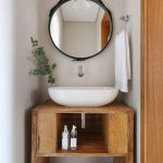 Wooden Small Vanity, White Wall, White Sink, Round Mirror, White Towel