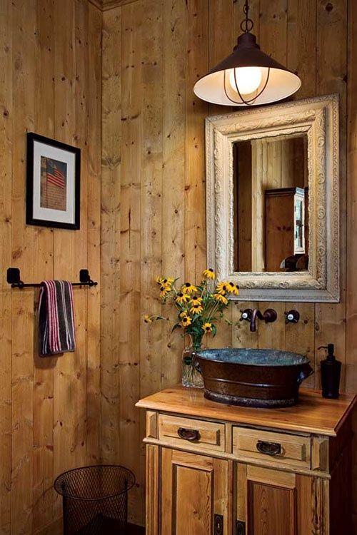 wooden vanity cabinet, wooden wall, white mirror, pendant, metal sink