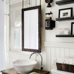 Wooden Vanity, White Wooden Wainscoting, Whtie Wall, Black Floating Shelves, Black Framed Mirror, White Toilet