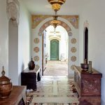 Arch, White Wall, Orange Painted Decoration, White Wall, Orange Floor Tiles, Wooden Bench, Wooden Cabinet, Moroccan Pendant