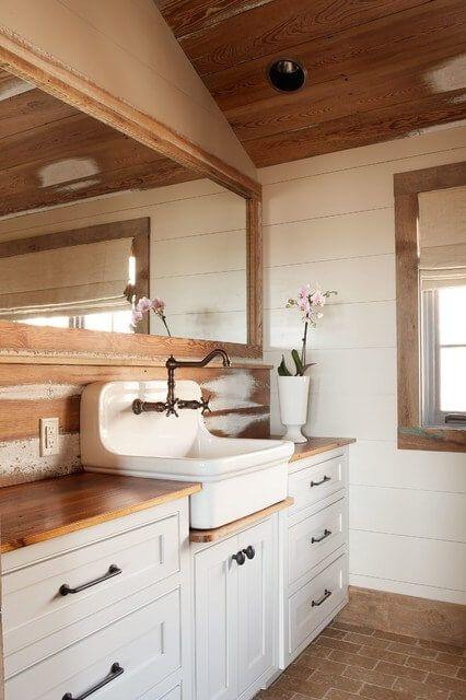 bathroom, brick floor tiles, white wooden planks, white cabinet with wooden counter top, white sink