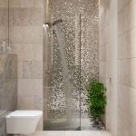 Bathroom, Cream Floor, Cream Wall Tiles, White Floating Toilet, Glitter Accent Wall, Shower, Grey Marble Wall