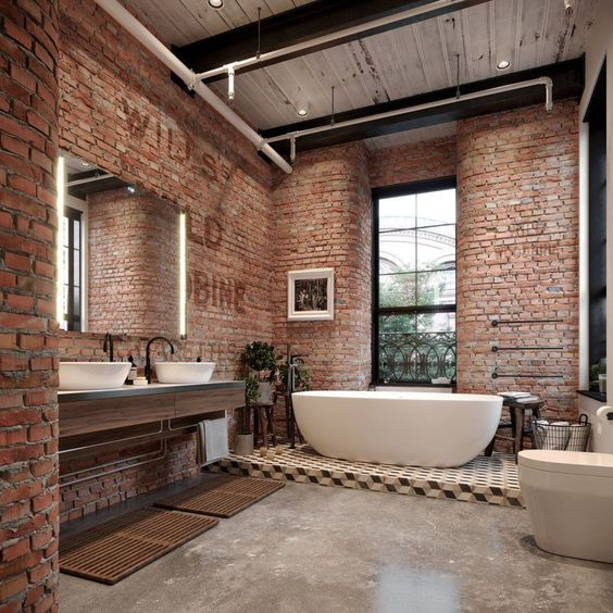 bathroom, grey seamless floor, exposed brick wall, floating vanity, white sink, white tub, tall glass window, white toilet