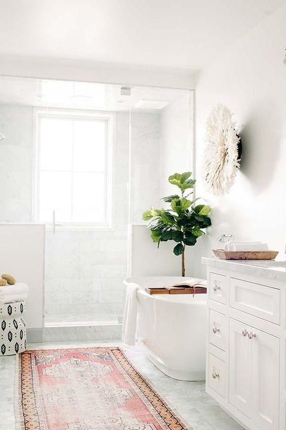 bathroom, off white floor, white wall, wite tub, white cabinet, white tiles