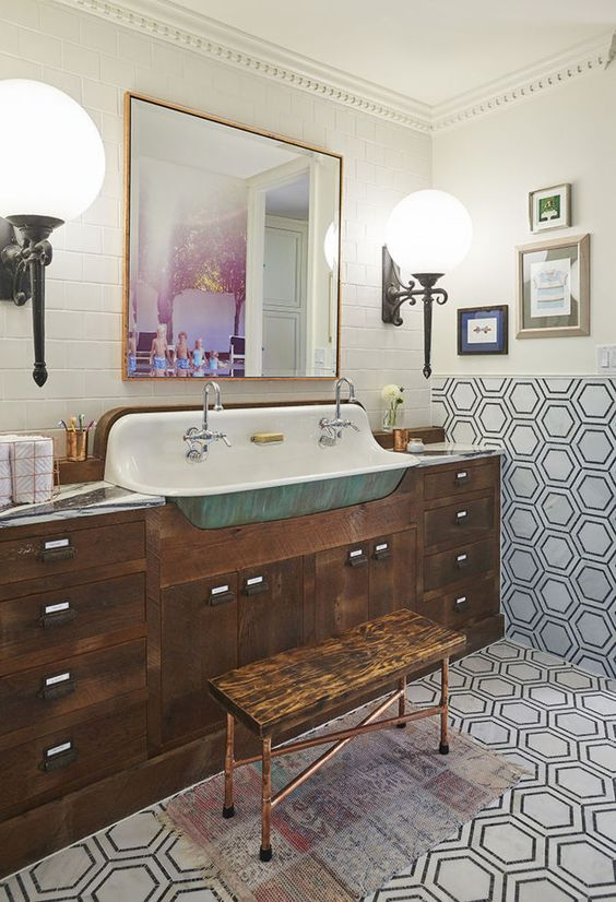 bathroom, patterned floor and wall, white wall planks, blue long farmhouse sink, wooden cabinet, white bulbs sconces, square mirror, wooden bench