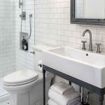 Bathroom, Tiny Hexagonal Floor Tiles, White Subway Wall Tiles, White Rectangular Sink, Black Metal Vanity, Black Framed Mirror, Wihte Toilet