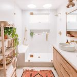 Bathroom, White Bathroom, Wooden Cabinet With White Top, White Round Sink, Wooden Shelves, White Tiles, Indented Wall, Rug
