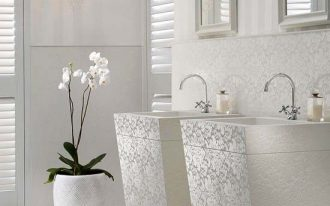 bathroom, white marble floor, white wall, detailed white backsplash and vanity sink, white striped wall, chandelier