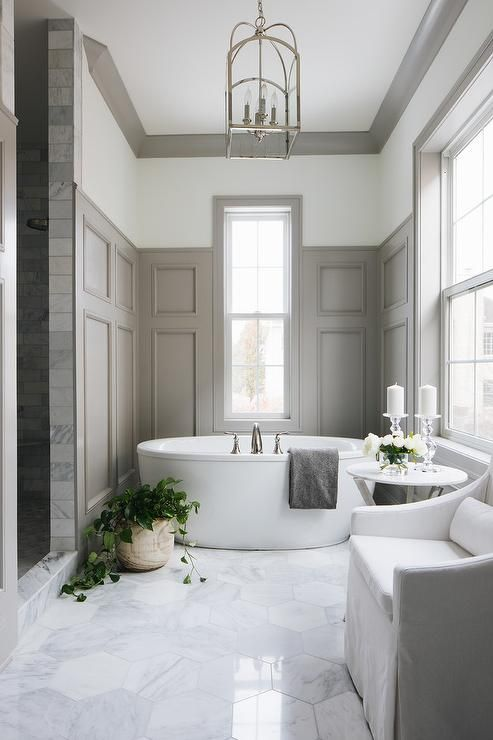 bathroom, white marble floor, white wall, grey wainscoting wall, white tub, white chair,