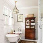 Bathroom, White Marble Floor, White Wall, White Wooden Planks, Brown Wooden Cabinet, White Tub With Claw, White Golden Pendant