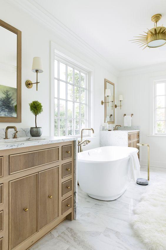 bathroom, white marble floor, white wall, wooden cabinet, marble counter top, white tub, golden lamp, golden pendant