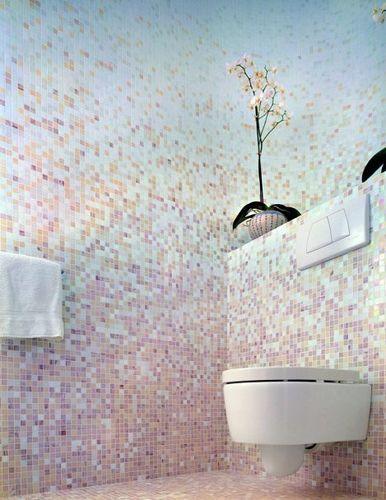 bathroom, white pink tiny wall tiles, white floating toilet, shelving