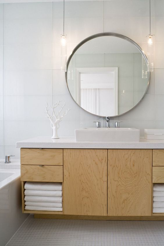 bathroom, white rubber flooring, white wall tiles, round mirror, glass pendants, wooden floating cabinet with white counter top, white sink