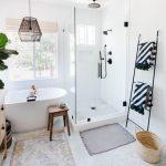 Bathroom, White Tiny Hexagonal Floor Tiles, White Wall, Glass Partition, White Tub, Black Iron Cage Pendant, Wooden Stool, Black Rack