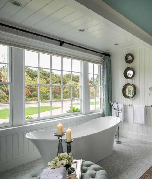 bathroom, white tiny tiles, white wooden wall and ceiling, blue ceiling, glass windows, white tub