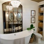 Bathroom, White Wall Tiles, White Tub With Silver Claw Tub, Patterned Floor Tiles, White Toilet, Rattan Baskets